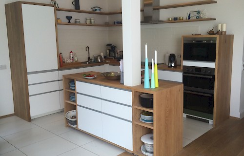 Hand-made kitchen with oak worktops, Belfast sink and built-in larder