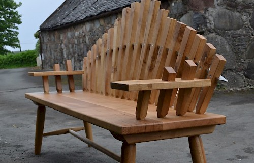 Shaped oak garden bench to celebrate a silver wedding anniversary